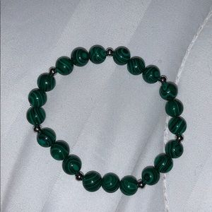 a green and black beaded bracelet